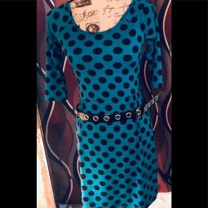 Turquoise dress with black polka dots and belt